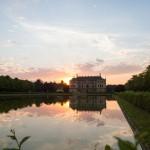Zachód słońca nad pałacem w Großer Garten