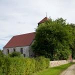 Dominikowo. Kościół z szachulcową wieżą z końca XVI w